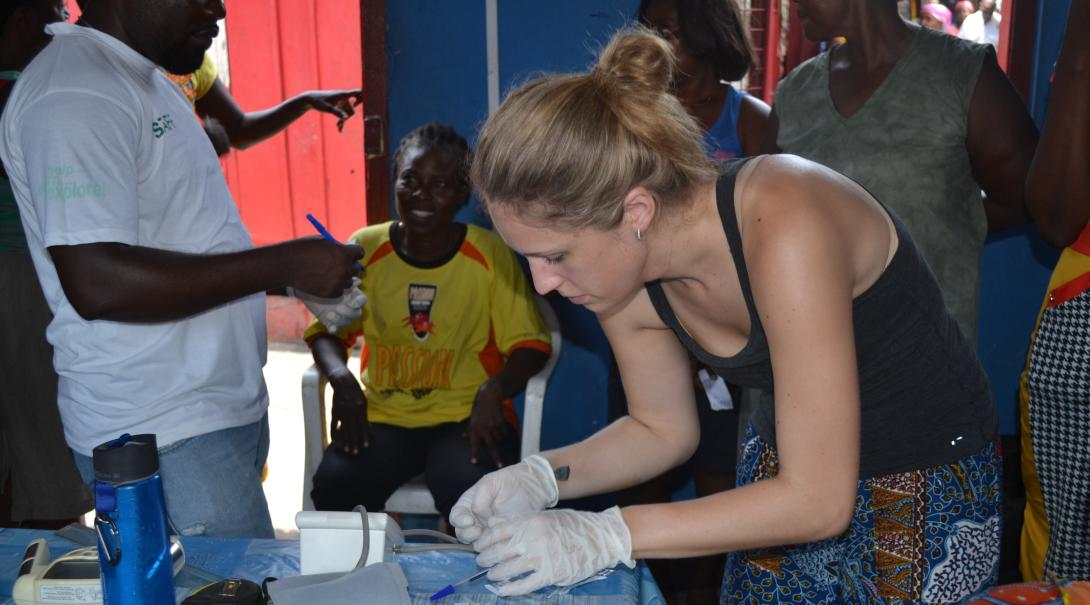 Projects Abroad volunteer prepares materials for HIV/Aids campaign during her internship in Ghana.